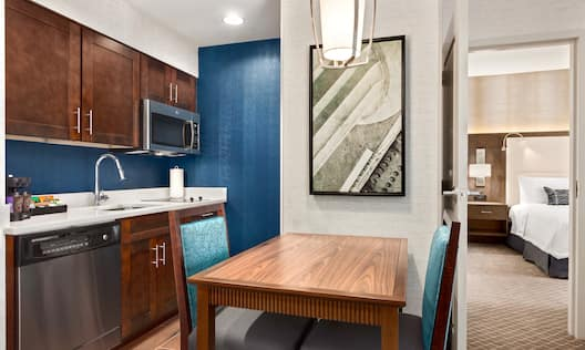 Suite Living Area with Kitchen and Entry to Bedroom