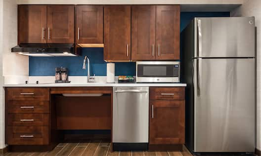 Studio Suite Kitchen with Microwave, Stove and Full Refrigerator