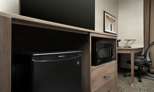 Desk, Microwave and TV in Room