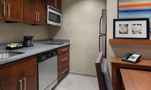 Kitchen area with microwave and fridge