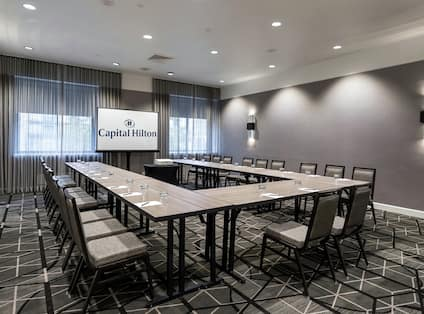 Ohio Meeting Room with U-Shaped Table, Chairs, and Projector Screen