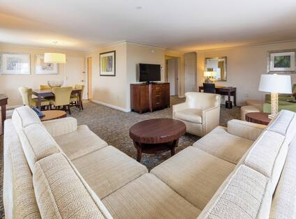 Rowan Suite Living Room with Lounge Area, Work Desk, Dining Area, and Room Technology