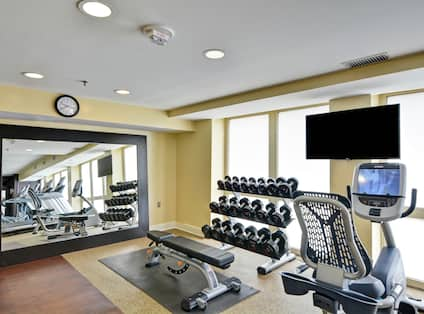 Fitness Center with Dumbbells, Exercise Bike, and Room Technology