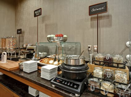 Breakfast Buffet with Baked Goods Cereals and Oatmeal