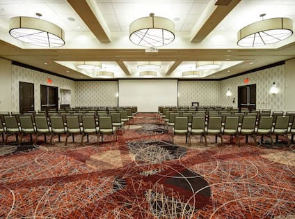 Hunter Ballroom Meeting Setup with Rows of Chairs and Projector Screen