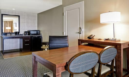 Guest Room with Table Chairs and Wet Bar Kitchen Area
