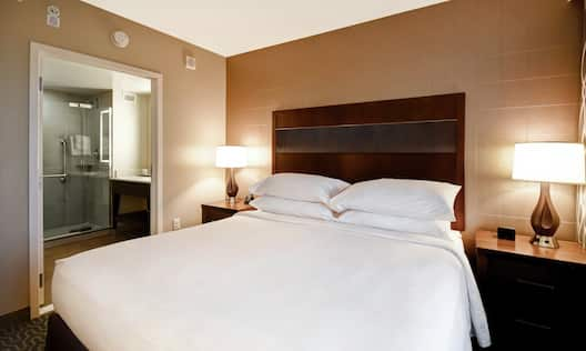 Guest Room with King Bed and View of Bathroom