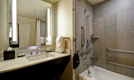 Guest Bathroom with Vanity Mirror Shower and Tub