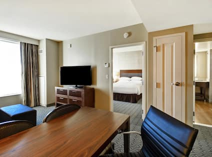 Suite Living Area with Table Chairs Television and Entry to Bedroom