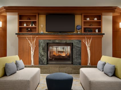 Lobby Seating Area with Fireplace, Soft Seating and Wall Mounted TV