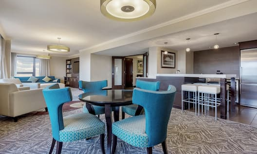 Presidential Suite Living Room And Dining Table And Kitchen