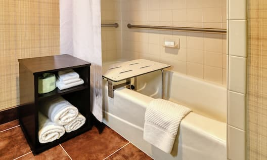 Accessible Guestroom Bathroom with Bathtub, Shower, Grab Bar, and Shower Bench