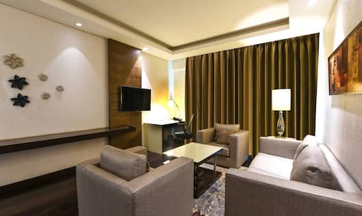 Lounge area with comfortable seating and TV