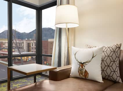 King Bed Living Area with Leather Couch, Throw Pillows and Mountain Views