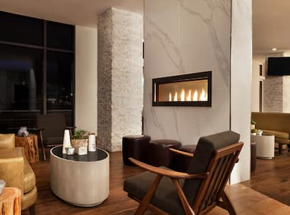 Bar Lounge Seating Arae with Fireplace, Sofa, Coffee Table and Armchair