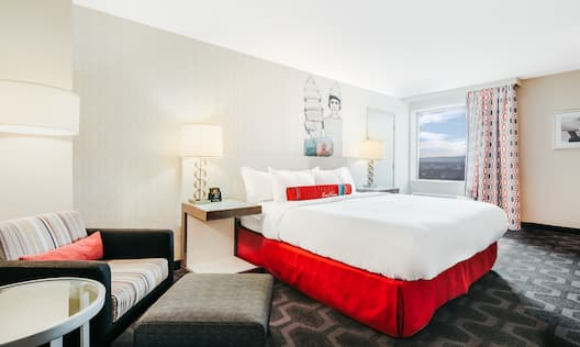 Guest Room with Bed Sofa and Small Round Table