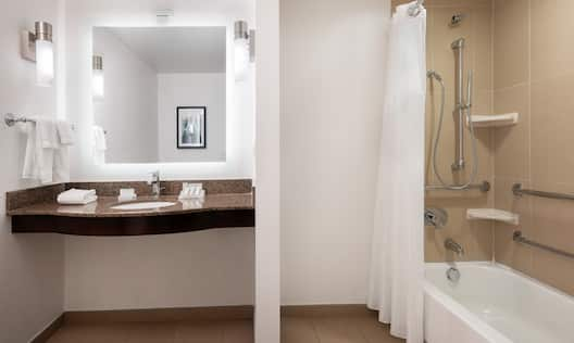 Accessible Guest Bathroom Vanity and Tub with Grab Bars
