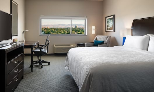 Mountain View King Guest Room with Television and Work Desk