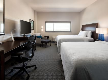 Double Queen Guest Room with Work Desk and Television