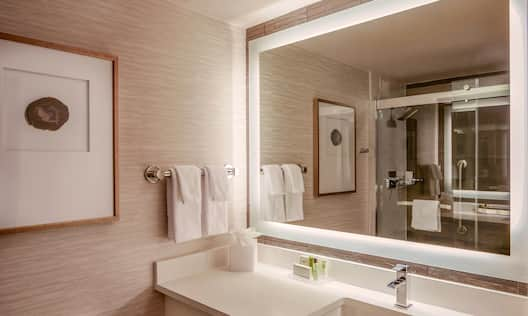 Bathroom Vanity Area with Lit Mirror