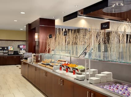 Breakfast Buffet With View of Beverage Area, Toast, Pastries, Fruit, and Yogurt