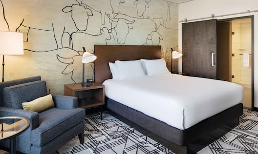 Standard Guest Room with King-Sized Bed, Armchair, Side Table and Lamp
