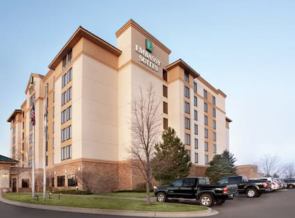 Daytime View of Hotel Exterior and Parking Lot