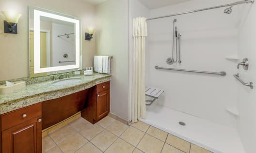 Accessible Roll-In Shower with Shower Seat, Grab Bars, and Handheld Showerhead
