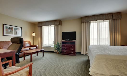 Studio suite with king sized bed sofa desk and tv