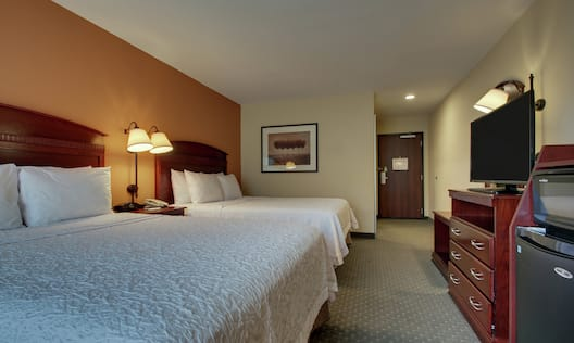 Guest Room With 2 Queen Beds, TV, and Microfridge