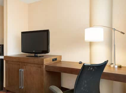 Guestroom with Work Desk, Television, Microwave and Mini Fridge