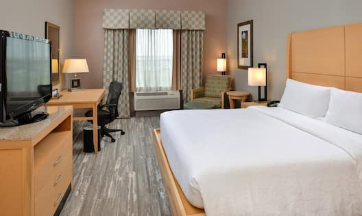 Guest Room with Large Bed Desk and HDTV