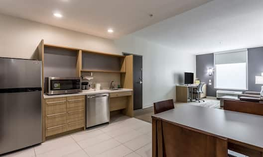 Guestroom In-Room Kitchen Area with Microwave and Fridge