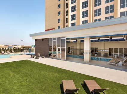 View of Outdoor Pool and Lawn Area