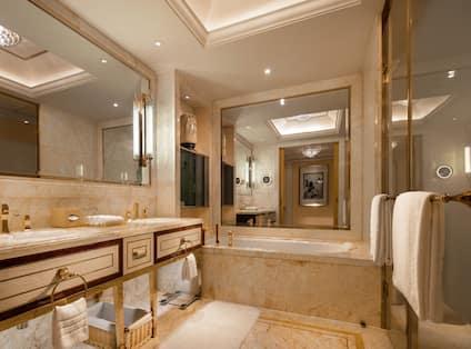 Bathroom area with mirror and bathtub