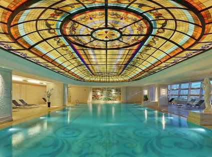 Indoor pool with ornate ceiling