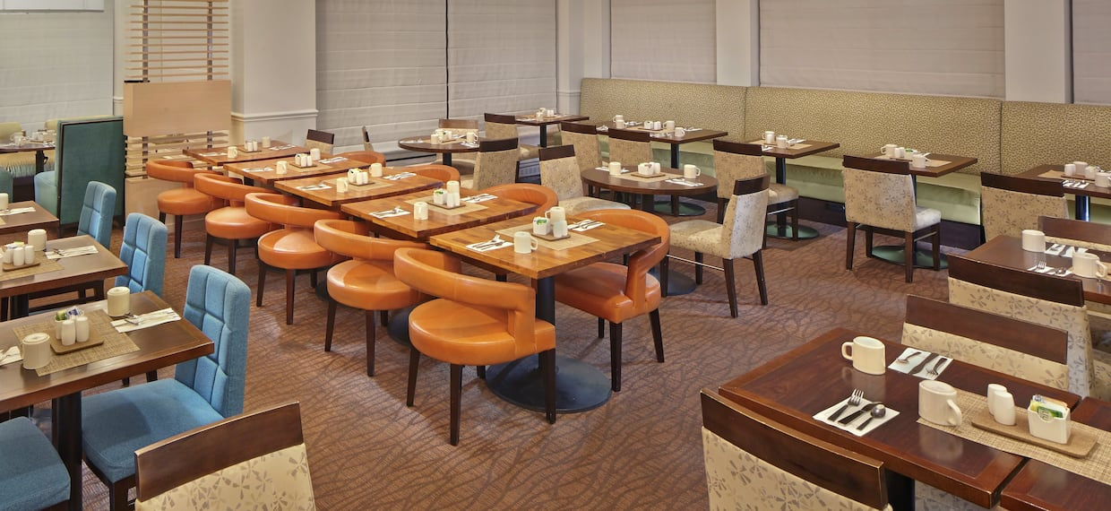 Tables, Booth Seating, and Chairs in Dining Area