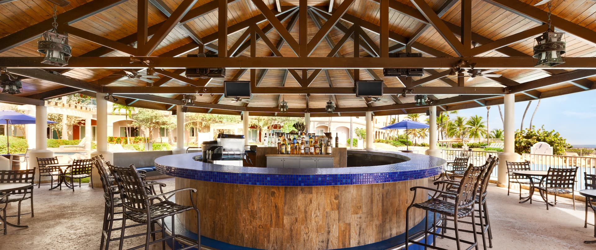 Outdoor Pool Bar Area with Bar Counter and Bar Stools