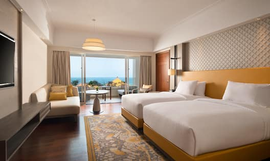 Twin Deluxe Guest Room with HDTV Sofa and Ocean View