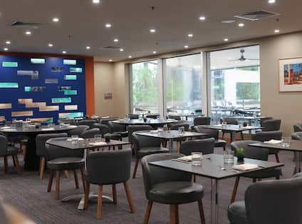 Restaurant seating area with tables and chairs
