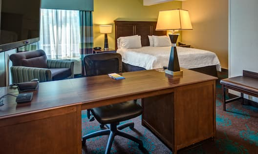 Room with Bed, TV, Work Desk, and Lounge Chair