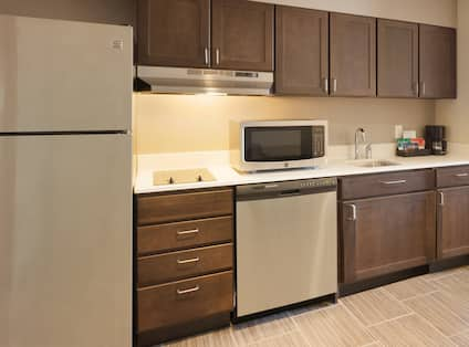 Suite Kitchen Area with Stainless Steel Appliances
