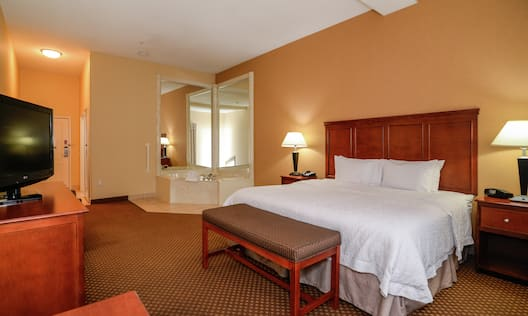 King Guestroom with Bed, Room Technology, and Whirlpool Tub