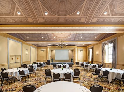 Ballroom round tables and a large projection screen