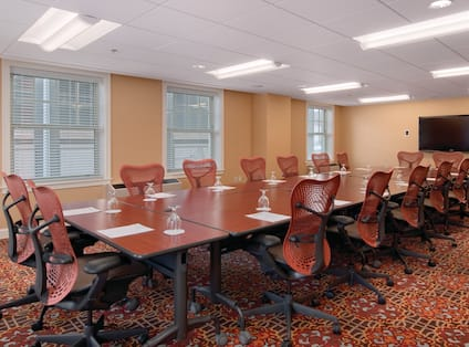 Chairs at a large table in a boardroom