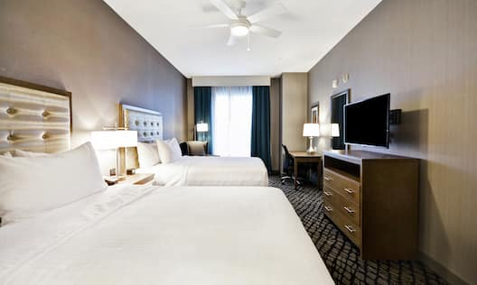 Suite with Queen Beds, Work Desk, and Television