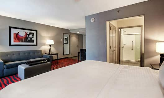 King Guestroom with Bed, Lounge Area, and Bathroom with Walk-In Shower
