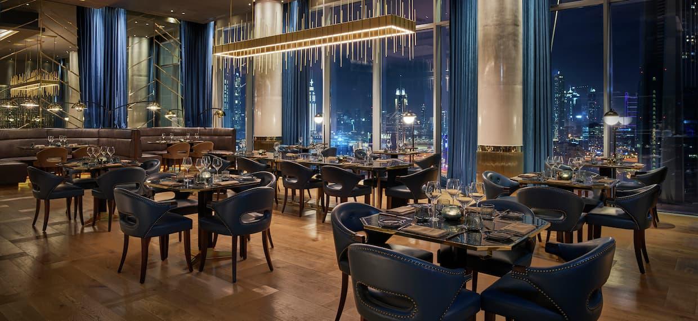 Bull & Bear seating with Dubai skyline at night