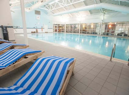 LivingWell Swimming Pool With Blue and White Striped Loungers