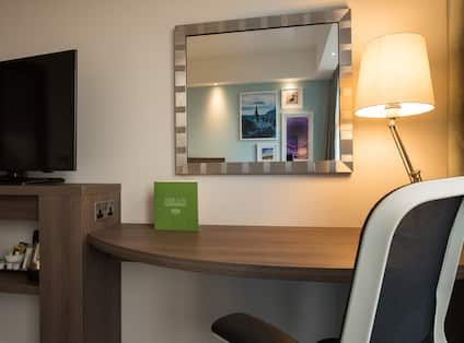 Guest Room Amenities Mirror, HDTV and Work Desk